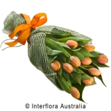 Orange tulip bunch wrapped in cloth and orange