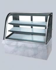 Cake display with curved glass